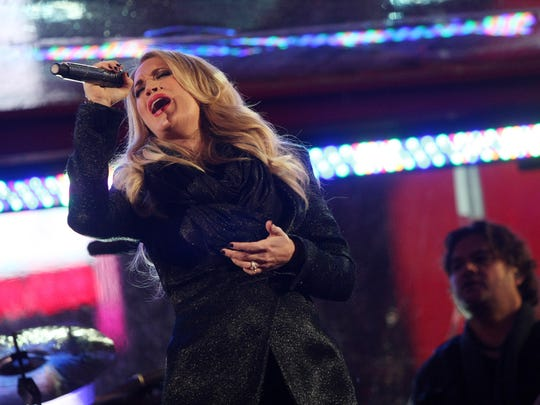 Carrie Underwood performs in Times Square, Monday, December 1, 2014, during a surprise World AIDS Day concert in New York, NY.