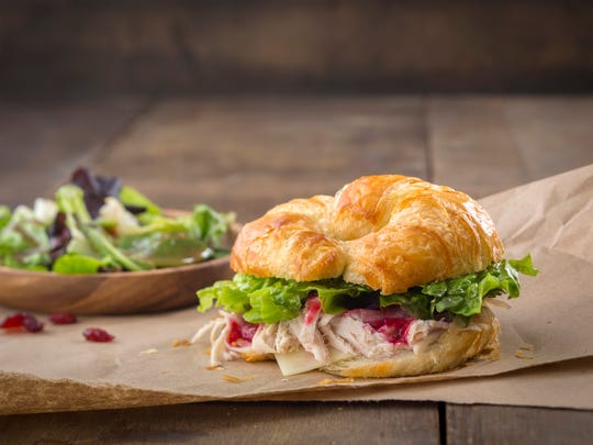 The chicken-cranberry croissant sandwich from Kneaders