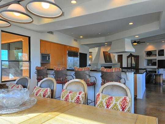 Gourmet kitchens with stainless steel appliances, oversized