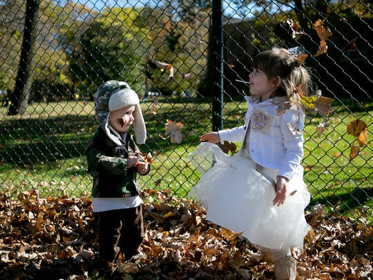 Children participate in the trick-or-treat event at Wildwood Zoo in Marshfield on Saturday, Oct. 11, 2014.