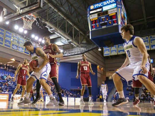 Delaware forward Skye Johnson (left) grabs a rebound