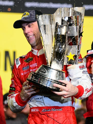 Kevin Harvick holds the Sprint Cup championship trophy