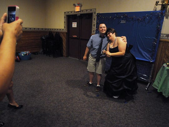 Students have their photograph taken at Abilities First School prom.