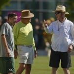 At right, Green Bay Packers general manager Ted Thompson visits with former Packers general manager Ron Wolf and Eliot Wolf, director of player personnel, during training camp practice at Ray Nitschke Field on Saturday, Aug. 1, 2015.