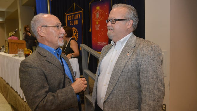Rabbi Harley Karz-Wagman (left) talks with Brent Henley, a practicing industrial psychologist, who was the guest speaker at the Rotary Club of Alexandria Tuesday.