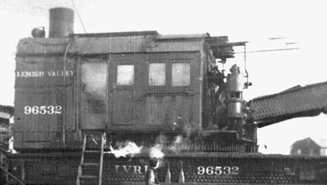 A youngster observes the mystery of Lehigh Valley Railroad crane No. 96532 in Sayre in this undated photograph.