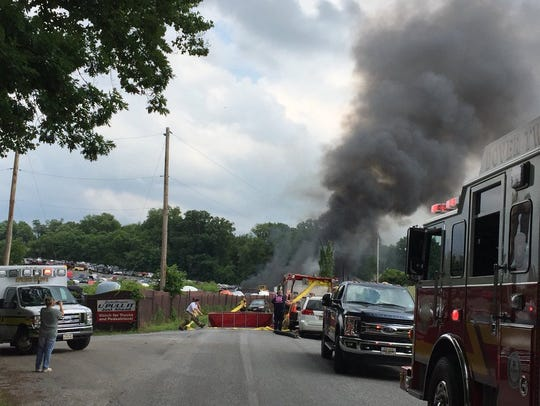 Smoke billows from a fire at a salvage yard in North