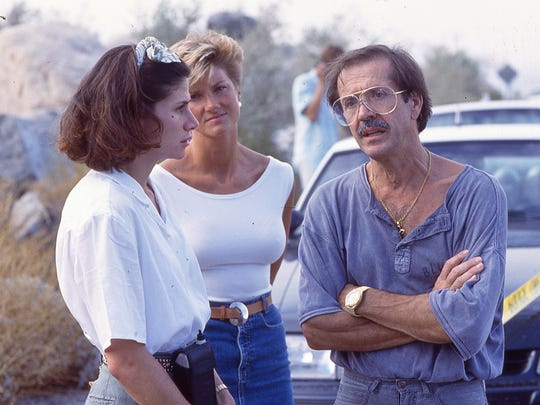 Mary Bono (left) talks to husband and Palm Springs Mayor Sonny Bono at the site of the Girl Scouts bus crash on Tramway Road in Palm Springs, July 31, 1991.