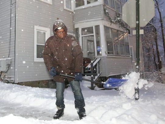J W Browner shovels his sidewalk in the City of Poughkeepsie