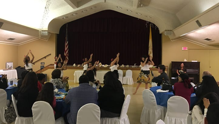 Uno Hit Chamorro dancers entertain attendees at the