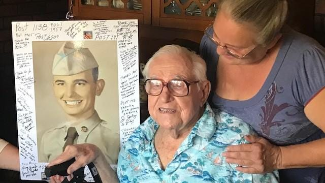 Harold McLean, a WWII veteran, celebrated his 96th birthday with his caregiver, Cheryl Gedert. ProMedica Hospice staff created the poster board with his Army photo.