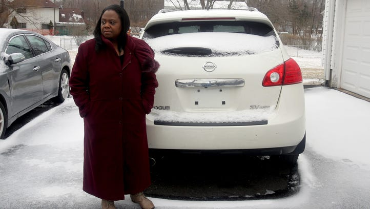 Deloris Ritchie of Hillcrest waits outside her home