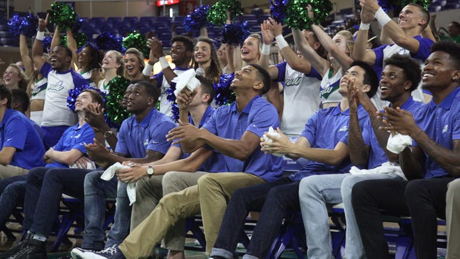 Members of the FGCU men's basketball team react to playing Fairleigh Dickinson while watching the NCAA tournament selection show on Sunday.