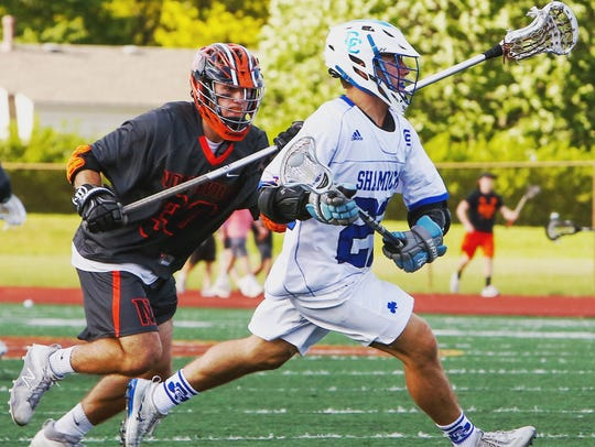Catholic Central's Nick Captaina is pursued by Northville's