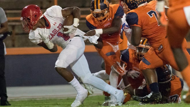 Jacob Copeland (1) tries to break away from the Escambia defense during the game Sept. 30. Copeland announced Tuesday that he is transferring to Escambia
