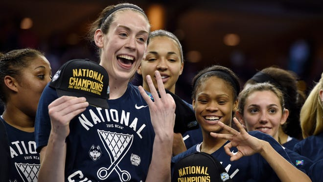 Connecticut Huskies forward Breanna Stewart (left) and guard Moriah Jefferson (right) show three fingers signifying the Huskies third consecutive national championship.