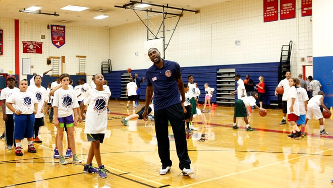 NBA player Elton Brand watches a shot with a camper at the Elton Brand youth basketball clinic, Aug. 1, 2014, at Peekskill High School. Brand, a Peekskill High School star, is a free agent and is in the twilight of his NBA career.
