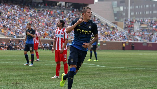 This file photo from 2014 shows forward Stevan Jovetic celebrating scoring a goal for Manchester United at TCF Bank Stadium in Minneapolis.