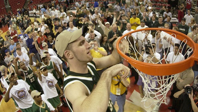 CSU forward Brian Greene celebrates after his team won the Mountain West Conference Basketball Championship on Saturday, March 15, 2003 at the Thomas and Mack Center in Las Vegas.
