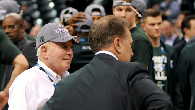 Doug Herner on the court with head basketball coach Tom Izzo after the Spartans 66-62 win over Purdue in the Big Ten Tournament Championship game on March 13 in Indianapolis.