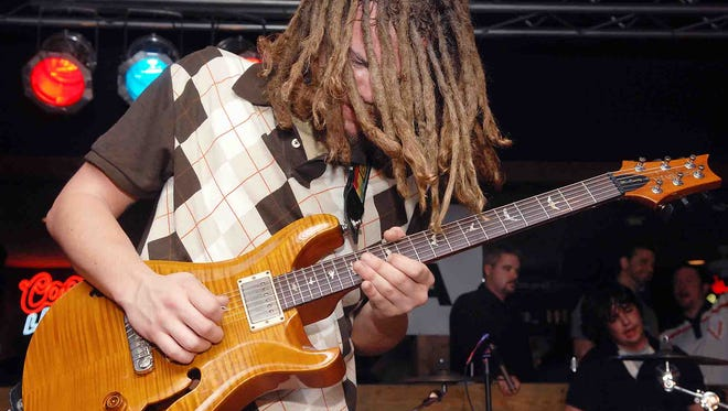 SOJA's Trevor Young performs with his old band, Seaford's Chowderfoot, at the Delaware Music Festival at The Rusty Rudder in Dewey Beach in 2008.