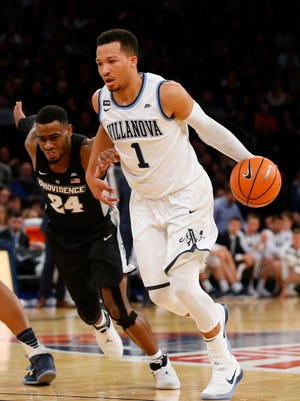 Villanova Wildcats guard Jalen Brunson (1) drives to the basket against Providence Friars guard Kyron Cartwright (24) during the Big East championship game.