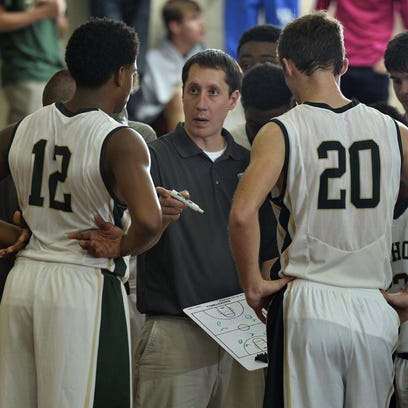 Catholic coach Nick Mead tries to map out a strategy