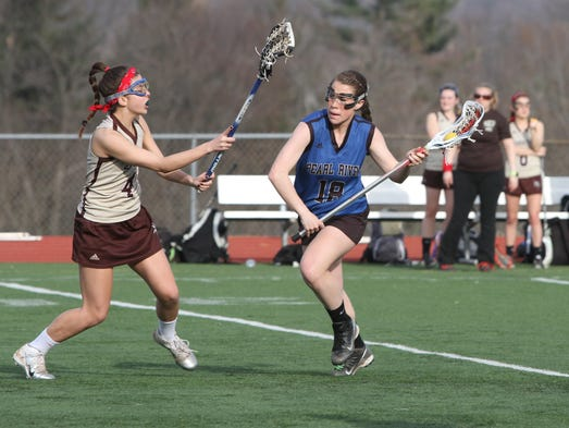 Pearl River's Kayla Moreau moves the ball up the field against Clarkstown South, during game action in girls lacrosse, in West Nyack, April 3, 2014. Pearl River beat Clarkstown South, 11-9.