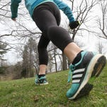 Democrat & Chronicle running reporter Victoria Freile looks at walking vs running to help stay fit, Monday, April 25, 2016 in Highland Park in Rochester.