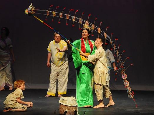 "Preston Workmen (from left), Steve Gilbertson, Jen Dickenson and Brandon Wynthein rehearse a scene from ""Ascent"" at Jeschke Fine Arts Center on Thursday, July 24, 2014"