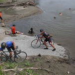 RAGBRAI riders dipped their tires into the water of the Missouri River on Saturday, July 23, 2016, near Glenwood in Southwest Iowa.
