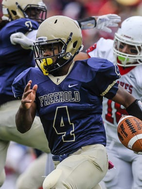 Freehold junior quarterback Ashante Worthy, shown running against Manalapan earlier this season, set the Shore Conference single-game rushing record by rushing for 465 yards Saturday in the Colonials' 69-56 win at Pennsauken in a NJSIAA Central Group IV quarterfinal.