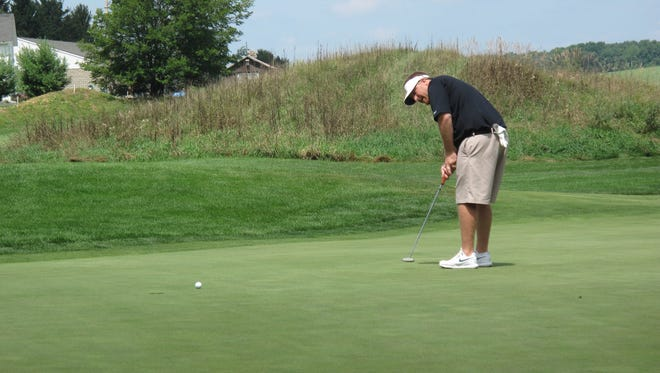 Mike Fisher putts on the 17th green at The Links at Union Vale.