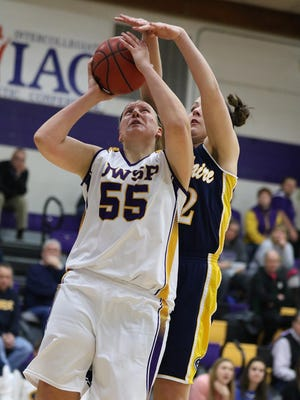 University of Wisconsin-Stevens Point's Joann Wolfenberg, left, shoots as UW-Eau Claire's Erin O'Toole defends during Wednesday's WIAC opener at UWSP's Berg Gym. The No. 24 Pointers earned a 59-52 victory.