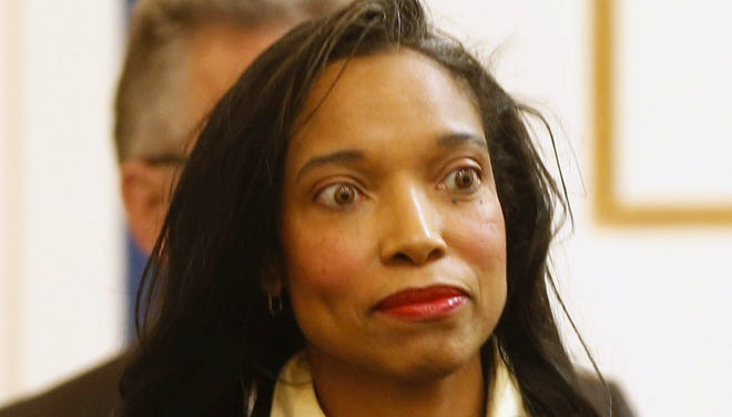Hamilton County Juvenile Court Judge Tracie Hunter arrives for her arraignment on nine felony charges before Hamilton County Common Pleas Court Judge Norbert Nadel on Jan. 17.