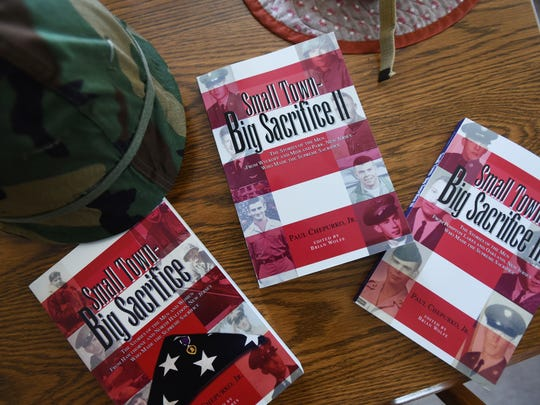 """After tracking down the story of every member of the armed forcesfrom Hawthorne and North Haledon who was killed during military service, Chapurkowrote their biographies in a self-published book called """"Small Town —Big Sacrifice."""""""