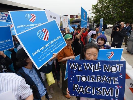 Korean Americans gather to protest against the racial  comments made by Lorraine Rotundo, the mother of James Rotundo, Palisades Park Mayor, as they are outside of Palisades Park Town Hal in Palisades Park on 06/10/18.