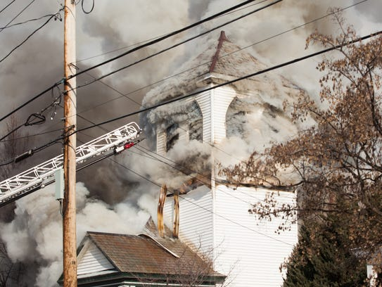 Smoke billows from the windows of the Free Methodist