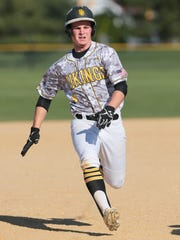 South Brunswick's Alex Pollock runs for third base