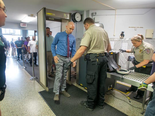 The line going through security was extra long due to a clerical error that more than doubled the number of dockets at the Santa Rosa County Courthouse in Milton on Tuesday, May 30, 2017.