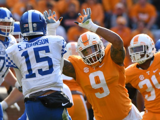 Tennessee defensive end Derek Barnett puts pressure on Kentucky quarterback Stephen Johnson during the Vols' 49-36 win Nov. 12 at Neyland Stadium.