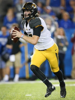 In this file photo, Missouri quarterback Maty Mauk looks for a receiver during the second half of an NCAA college football game against Kentucky, Saturday, Sept. 26, 2015, in Lexington, Ky.