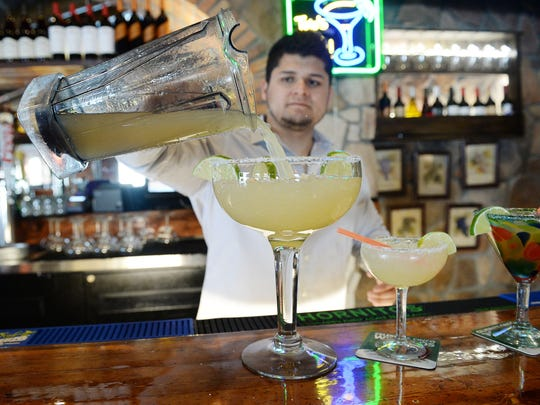 Hugo Caballero, Jr. pours a King Margarita at La Buena Vida on Tuesday, April 26, 2016. The giant drink will be available this summer.
