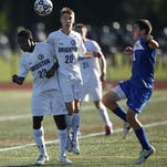 Brighton's Kyle Burns, center, heads the ball during the first half of the match against West Irondequoit boys varsity soccer team, Tuesday, Sept. 16, 2013.
