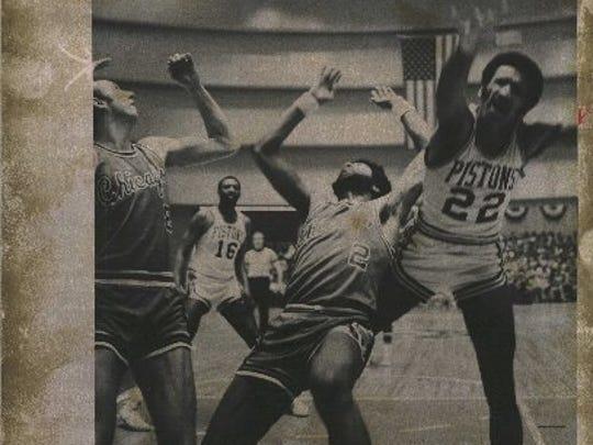 Pistons - 1974: Off-balance, Stu Lantz (right) scores basket against Bulls anyway.