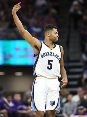 Memphis Grizzlies guard Andrew Harrison (5) celebrates after hitting a 3-point shot against the Kings in Sacramento Saturday.