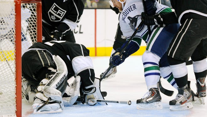 Los Angeles Kings goalie Jonathan Quick blocks a shot against the Vancouver Canucks during the second period at Staples Center.