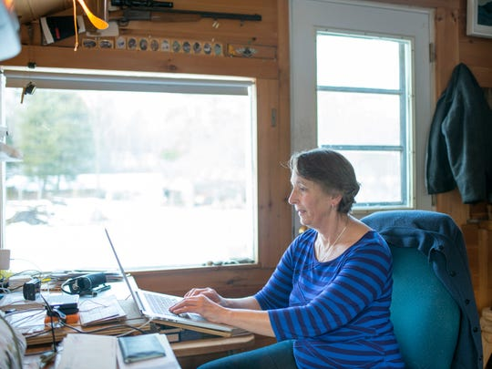 Annette Smith, executive director of Vermonters for a Clean Environment and 2016 Vermonter of the Year, works in her home office on Friday, Dec. 23, 2016, at the farm in Danby.