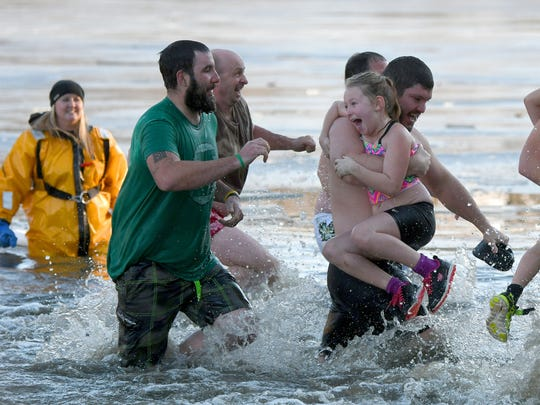 All ages enjoyed the chilly water on Sunday during