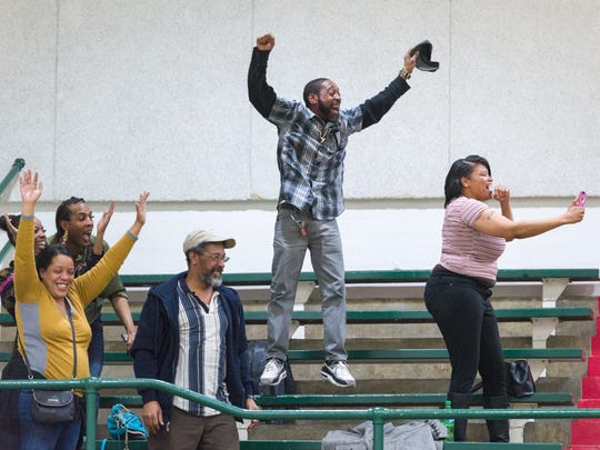 Courvoisier McCauley's family, including his mother, April McCauley, lower left, react to his last-second game-winning shot against Crispus Attucks in the City tournament.